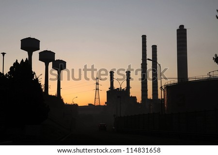 energy plant lighted in the sunset