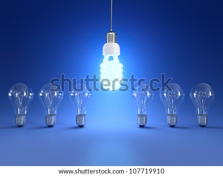Energy saving and simple light bulbs isolated on blue background.
