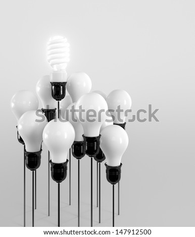 Energy saving and simple light bulbs isolated on brown background. - stock photo