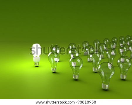 Energy saving and simple light bulbs isolated on green background. - stock photo