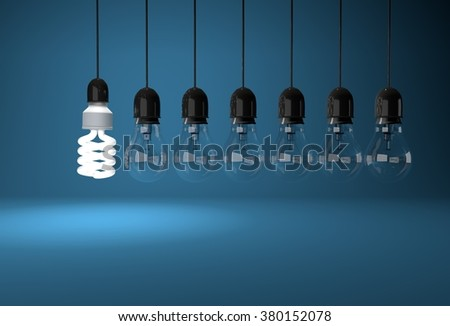 Energy saving bulb lighting room with incandescent bulb hanging on wires