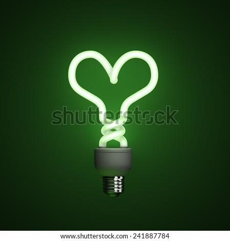 Energy saving compact fluorescent lightbulb, lamp on a green background with fine illumination - stock photo