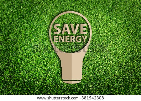 energy saving concept. Paper cut of eco on green grass. - stock photo