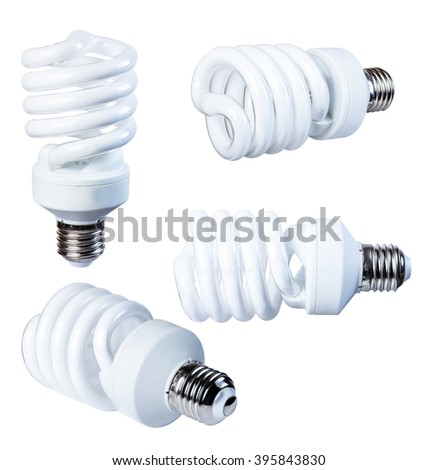 Energy-saving fluorescent lamp isolate on a white background, from different angles, closeup. - stock photo