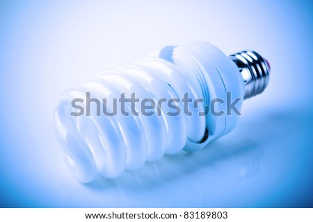 Energy saving fluorescent light bulb - stock photo