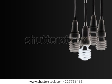 Energy saving fluorescent light bulb isolated on a black bakground