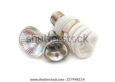 Energy saving fluorescent light bulb on white background - stock photo