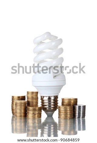 Energy saving lamp and money isolated on white - stock photo