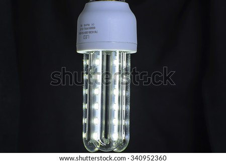 Energy saving LED light bulb on a black background.