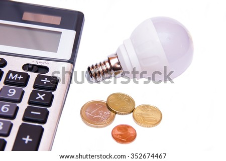 Energy saving light bulb and money on white background