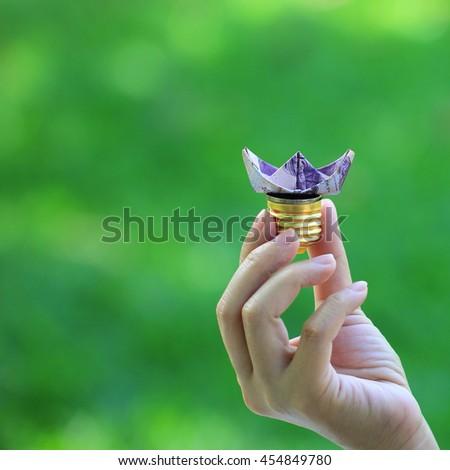 Energy saving light bulb, idea innovation concept. - stock photo
