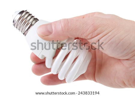 Energy saving light bulb with e27 screw base in hand , isolated on white  - stock photo
