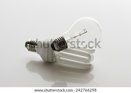Energy saving lightbulb and light bulb - stock photo