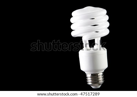 Energy saving lightbulb on black background - stock photo