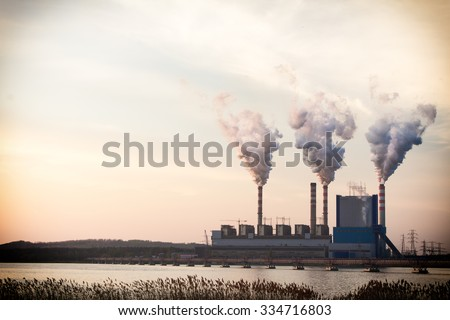 Energy. Smoke from chimney of power plant or station. Industrial landscape.