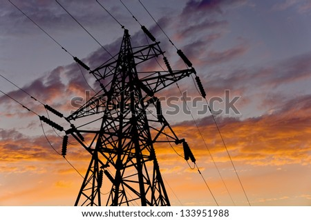 Energy tower on an electric sky background - stock photo