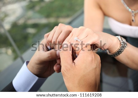 engagement, bride and groom hands close up ring - stock photo