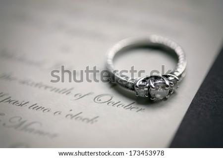 Engagement Ring On A Wedding Invitation - stock photo