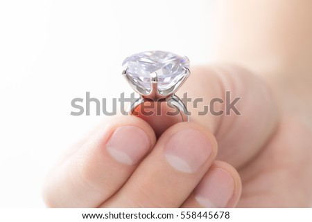 Engagement ring on hands