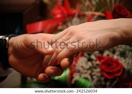 Engagement ring on womans hand held by her friend  - stock photo