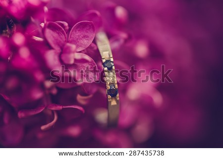 engagement ring with flowers - stock photo