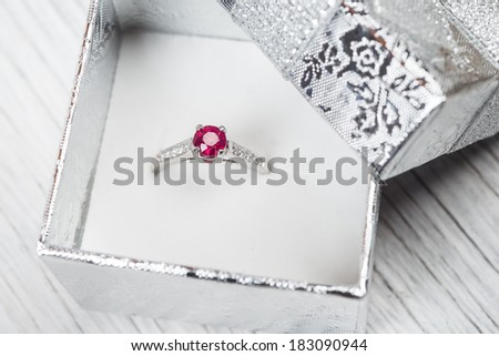 Engagement ring with gem in a box - stock photo