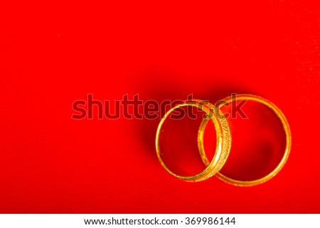 Engagement rings wedding with red background.