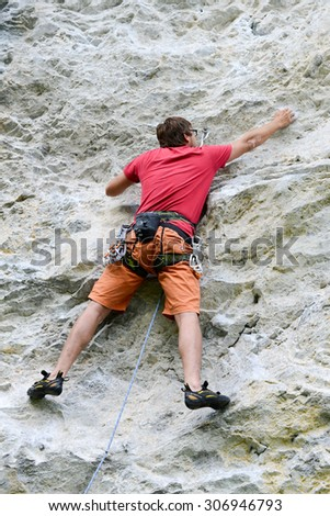 Engelberg, Switzerland - 10 August 2015: person climbing on the rock at Engelberg on the Swiss alps