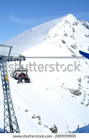 Engelberg, Switzerland - 10 january 2007: People ascending  mount Titlis on a ski lift over Engelberg on the Swiss alps