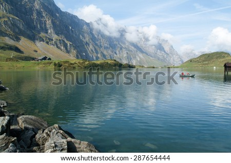 Engelberg,Switzerland - 25 September 2011: tourists rowing on a rowing boat on lake Trubsee at Engelberg on the Swiss alps