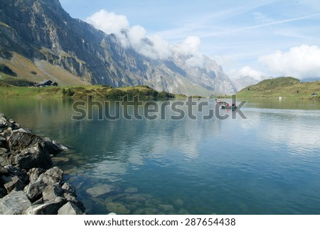 Engelberg,Switzerland - 25 September 2011: tourists rowing on a rowing boats on lake Trubsee at Engelberg on the Swiss alps