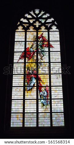 ENGHIEN, BELGIUM-NOVEMBER 2: Stained glass window in Saint-Nicolas parish church on November 2, 2013 in Enghien, Belgium. The church was built in 14-15 centuries and new vitrages in 1964. - stock photo
