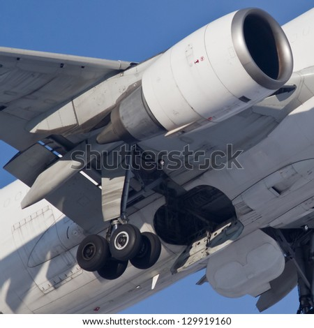 Engine and chassis during takeoff, closeup - stock photo