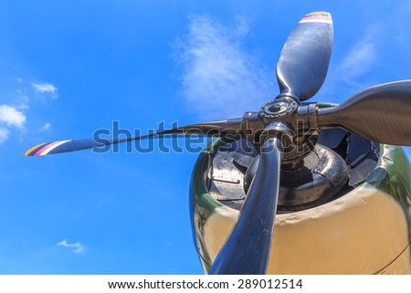Engine and propeller closeup from retro airplane - stock photo