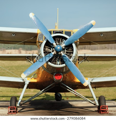 Engine and propeller of old vintage airplane. Photo in retro style. Frontal view of the propeller engine and cockpit. - stock photo