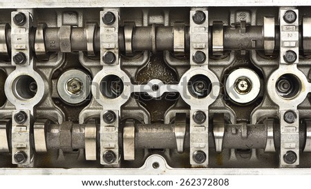 Engine camshaft cap close up - stock photo