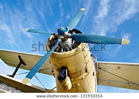 Engine of an old airplane from low angle - stock photo