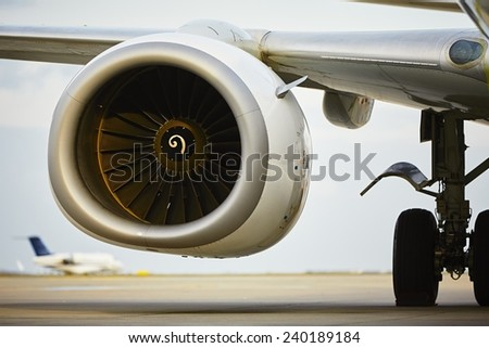 Engine of the airplane on the runway - stock photo