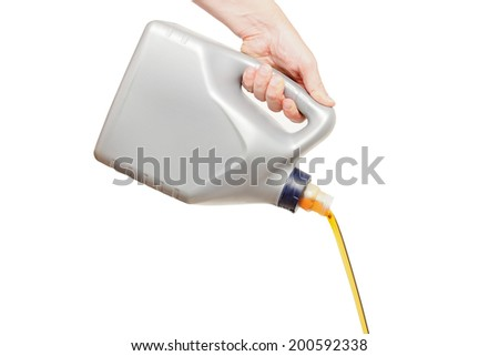 Engine oil pouring from a canister in hand isolated on white background - stock photo