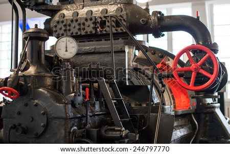 Engine. Part of old power plant. - stock photo
