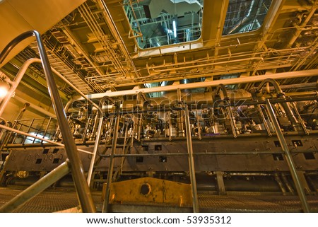 Engine Room Space onboard Large Ship - stock photo
