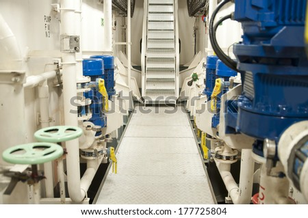 Engine Room Spaces on a modern vessel - engineering interior including pipes, cables, pumps - stock photo