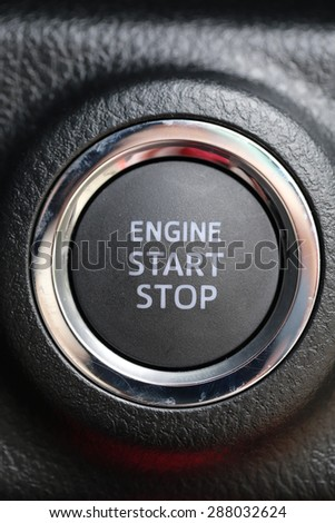 Engine start stop button of car - stock photo
