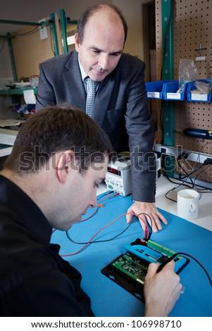 Engineer and Salesman talking - stock photo