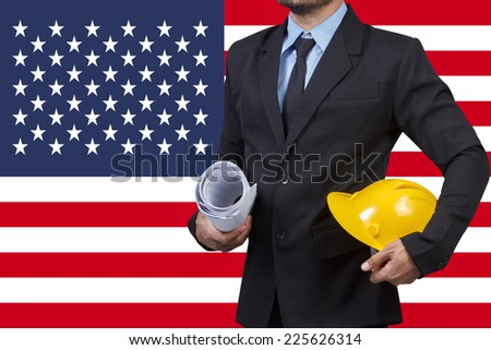 engineer and usa flag for working on labor day - stock photo