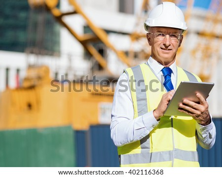 Engineer builder at construction site - stock photo