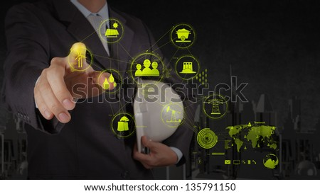 engineer businessman hand show world of industry as concept - stock photo
