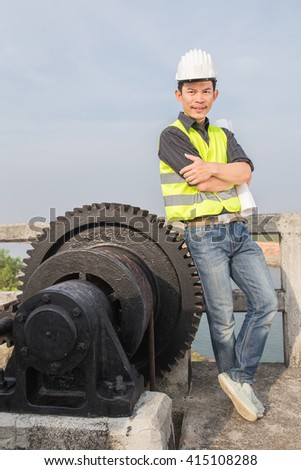 engineer check  mechanical gear with a large toothed wheel,  Floodgate valve