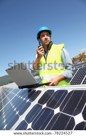 Engineer checking photovoltaic installation