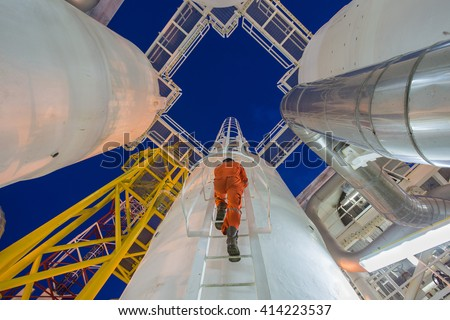 Engineer climb up to oil and gas process plant to observer gas dehydration processing and survey abnormal condition in night shift